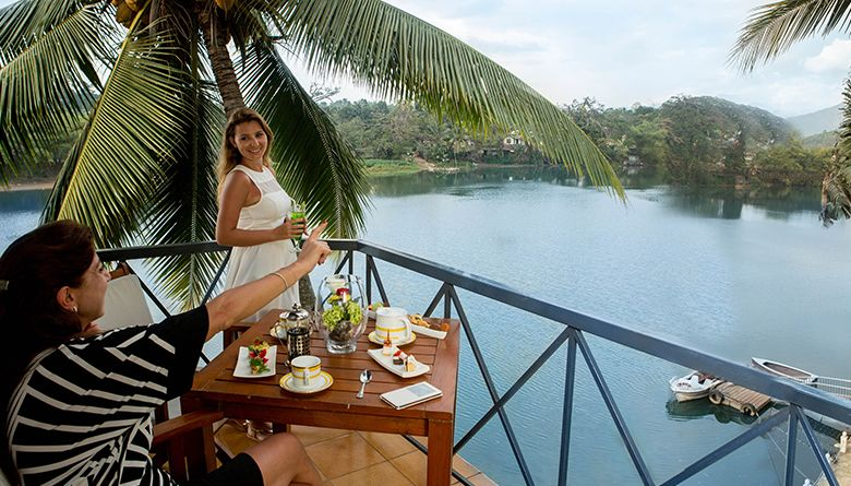 Guests Enjoying the View of the Mahaweli River from the Executive Suite
