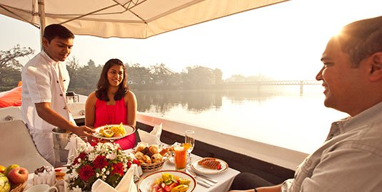 Couple Dining in the Boat at Mahaweli Reach Hotel
