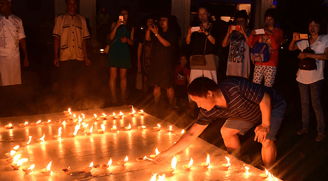 Lighting Candles during the Earth Hour at Mahaweli Reach Hotel